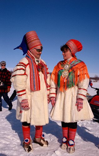 Sami couple wearing traditional clothes at Easter Reindeer races. Kautokeino. Norway.