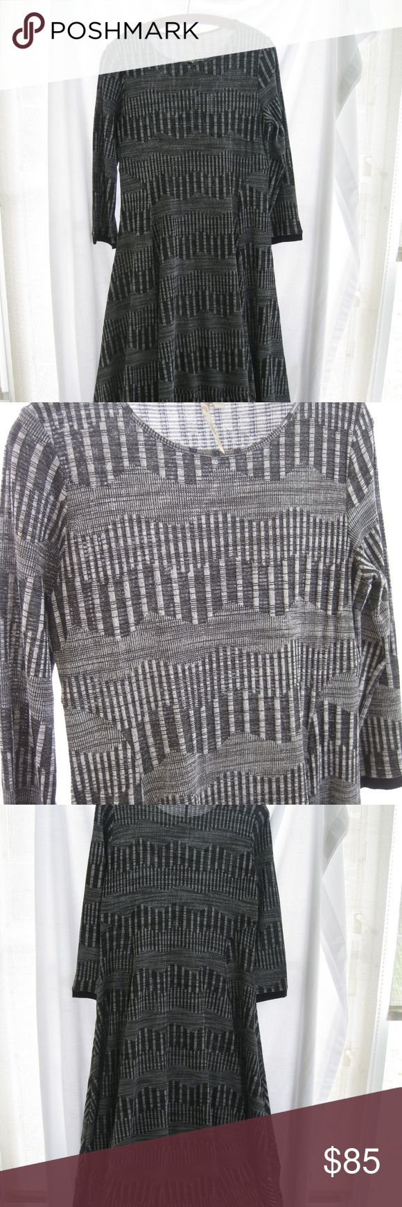 "Comfy U.S.A. funky lagenlook dress A fun bell shaped  knit all season dress. Size large, 36"" bust, 42"" from shoulder to hem. Silver gray black. Could be casual or very dressy. Perfect condition. A really versatile piece. Original price $178-$190 comfy USA Dresses Midi"