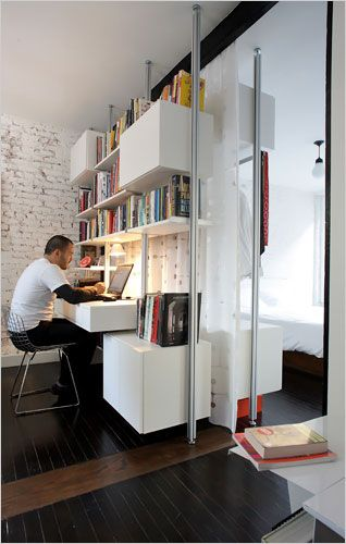 "office / closet systems with curtain in-between //  ""Infinite Storage Solutions, paying $4,300 for the back-to-back units, one of which incorporates a desk."" // wonder if a track system could be added to this to create movable walls."