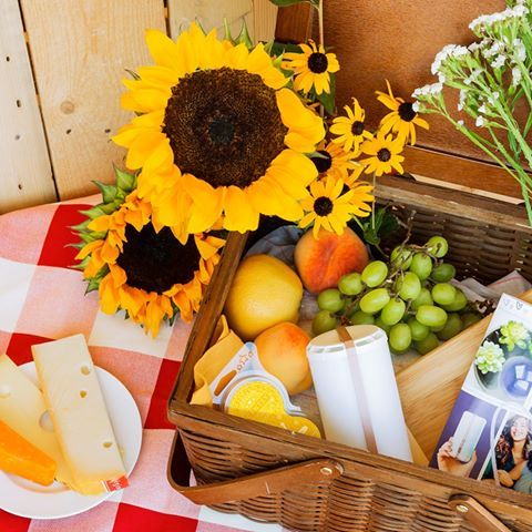 Fall Picnic/Date Idea! Set a romantic mood with a little bubbly & Scentsy Go fragrance. When it gets dark, enjoy the LED feature! #sunflowers #checkered cloth #picnic basket #fragrance #glamping
