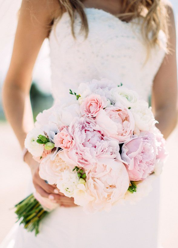 For the romantic, soft pink peonies are sure to please. We love the combination of two light tones for a modern twist. #WeddingBouquet