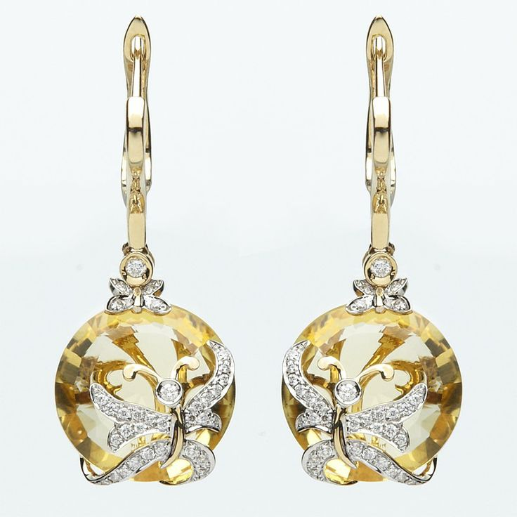 Steeped in elegance, these eye-catching citrine gemstone earrings enhanced by a multitude of genuine diamonds stand out against its 18 ct yellow gold setting