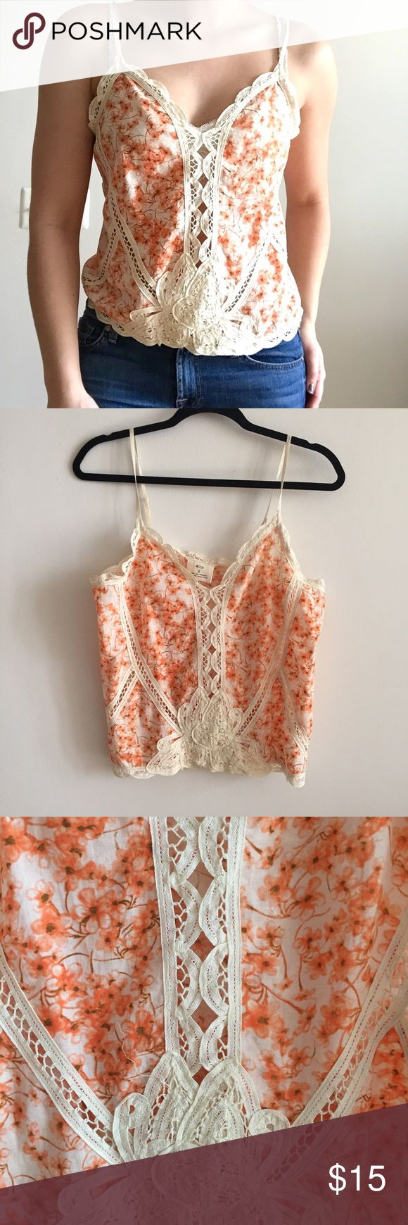 Urban Outfitters Orange Blossom Lace Tank A super cute Urban Outfitters Orange Blossom Lace Tank that is perfect for summer! It's so light and breezy, I've had it for years but it hasn't been worn in a while so it's time to let it go. It looks amazing with jean shorts and the cream lace provides the perfect girly accent. I typically wear a bralette under it to stay cool in the hot months. Urban Outfitters Tops Tank Tops