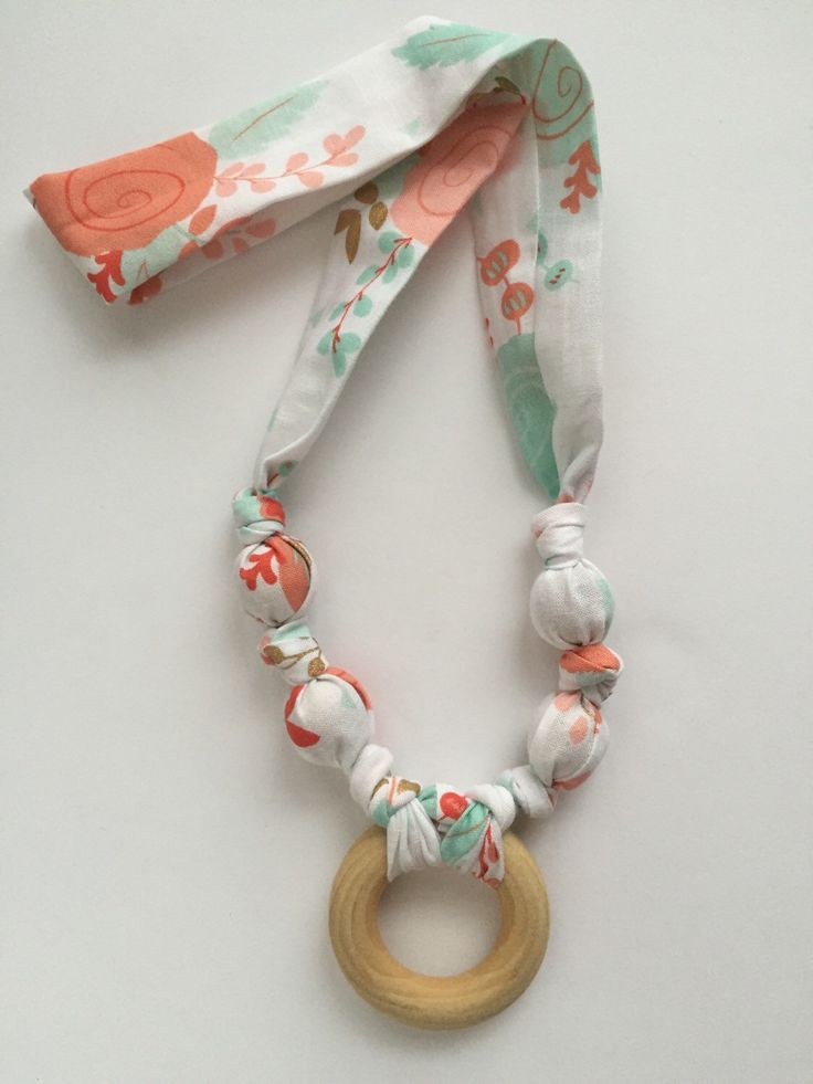 Nursing Necklace, Teething Necklace, Breastfeeding Necklace, Wood Beads & Ring in Beautiful Floral Print Cotton by CrunchieMomma on Etsy https://www.etsy.com/listing/271768550/nursing-necklace-teething-necklace