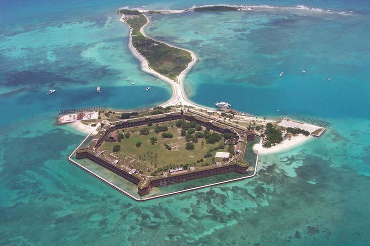 """Aerial of Fort Jefferson on Garden Key, part of Dry Tortugas National Park. The park is located at the farthest end of the Florida Keys, closer to Cuba than to the USA mainland. NPS says, """"To reach this remote ocean wilderness one must travel by boat or plane over 68 nautical miles of open sea."""" Garden Key is the second largest island in this chain..."""
