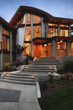 Amazing use of materials, and I don't usually like corrugated siding. Curved roof elements are lovely. Also, I usually don't like asymmetrical windows... which leads me to believe that those windows are part of a larger symmetry that is drawing me in.