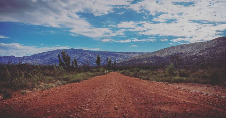 Beautiful Australian landscape of the Grampians National Park. Red dirt road to the mountains  #Grampians #nationalpark #Australia #road #dirtroad #Victoria #landscape #travel #Photography #sky #clouds #nature