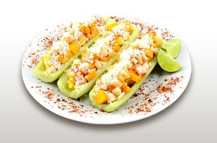 Chalupas!! Pepino cortado por la mitad sin semillas rellenó de mango (o cualquier fruta) con queso añejo, cebolla, limón, sal y Chile en polvo! Deliciosa