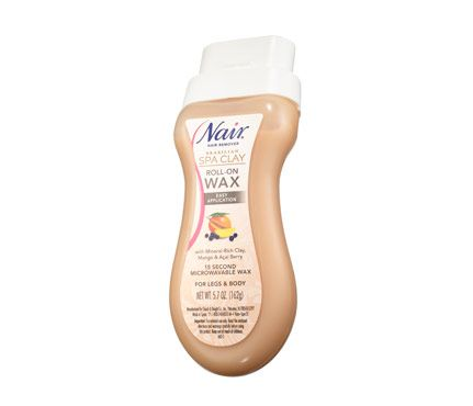"""My absolute favorite at-home waxer isn't a typical wax. The Nair Brazilian Spa Clay Roll-On Wax, $11, is formulated with water-soluble sugar—it's easy to rinse off if you chicken out. Stick it in the microwave for 15 seconds, roll over soon-to-be-bare areas, press on a cloth strip, then pull. The roller applies a thin layer of wax, just like the careful application of a pro."""