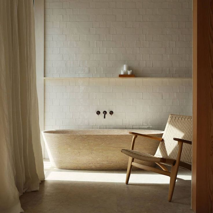 BATHROOM: Warm rustic tones, the relaxed Easy Chair designed by Hans Wagner and a bath that just beckons for you to soak - no wonder we are wistfully remembering Santa Clara 1728   Read the feature in est magazine issue 24