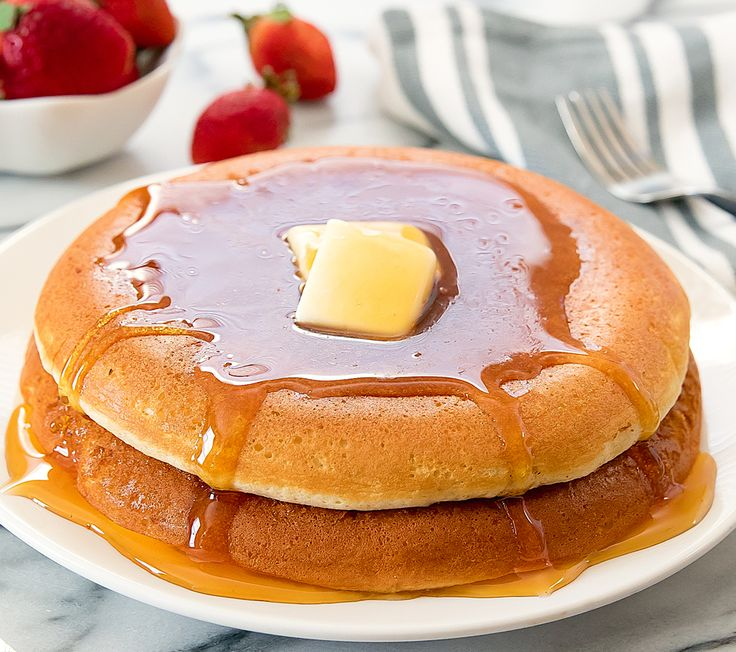 Fluffy giant Japanese-style souffle pancakes are a fun brunch or breakfast. They are cooked on the stove top and are a unique twist to traditional pancakes.