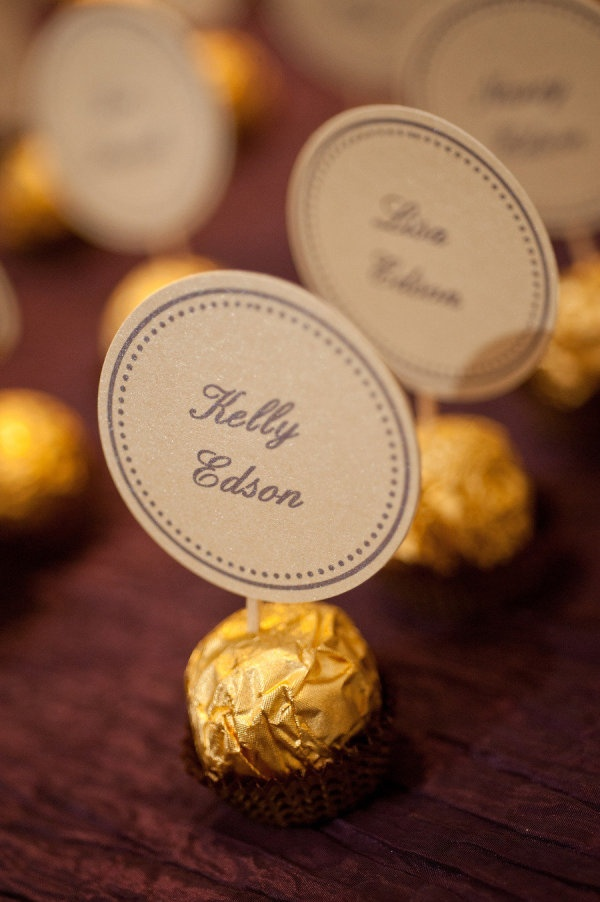 Rocher candies as escort card holders. Photography by sargeantstudios.com, Event Planning   Design by stonehouseevents.com, Floral Design by artistrydesignsgroup.com