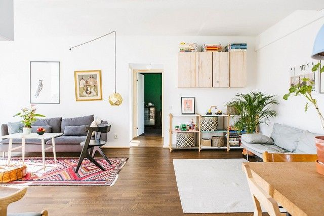 An open airy living plan with wood floors