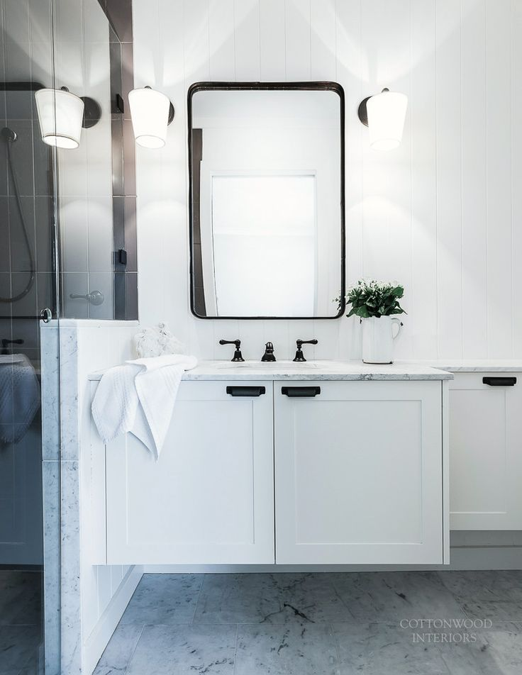 Ensuite bathroom with black tapware, carrara marble counters and floors | Cottonwood Interiors. Photo by Maree Homer.