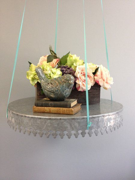We just can't get enough of this tray!! The functionality is endless! Use it as a traditional serving tray, a centerpiece, turn upside down for a unique cake stand, or create some real drama by suspending it from the ceiling as a floating table!