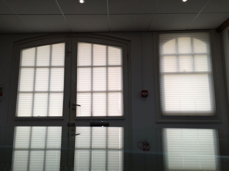 An Installation Of Pleated Blinds To Arched Windows In