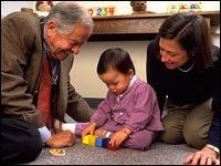 Dr. T. Berry Brazelton, with a young girl and her mother.