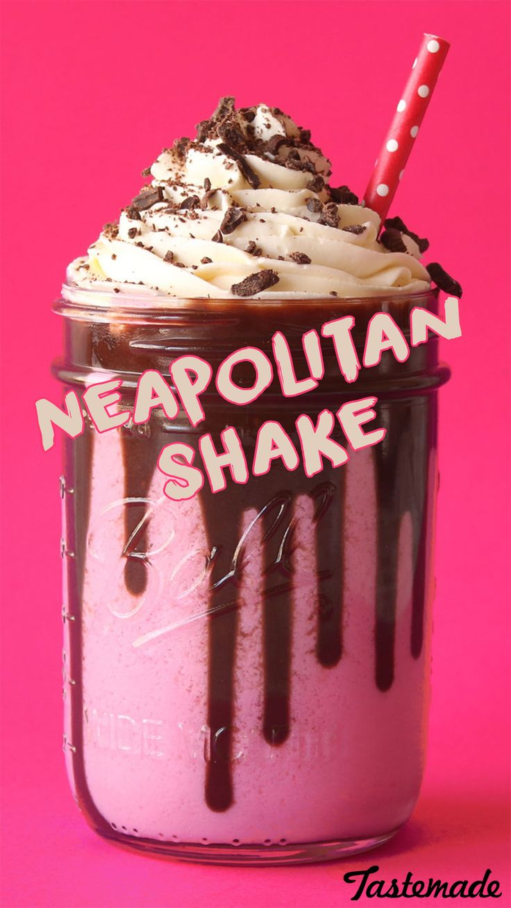 Yummy Strawberry Milkshake with chocolate drizzle topped with vanilla whipped cr…