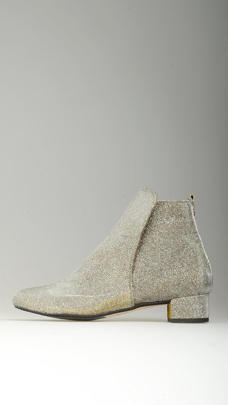 Laminated fabric embellished ankle boots in gold and silver featuring round toe, leather lined, elasticized side band, Californa slip-lasting method, 1.3'' of heel, rubber and leather sole, 100% fabric and leather.
