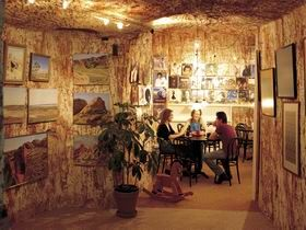 The Underground Art Gallery is conveniently located in the main street of Coober Pedy. The gallery is completely underground and is carved out of solid sandstone, it is quite large and includes a hands on mining area where you can put on a hard hat and get a bit on mining experience right in the middle of town. via Gaander