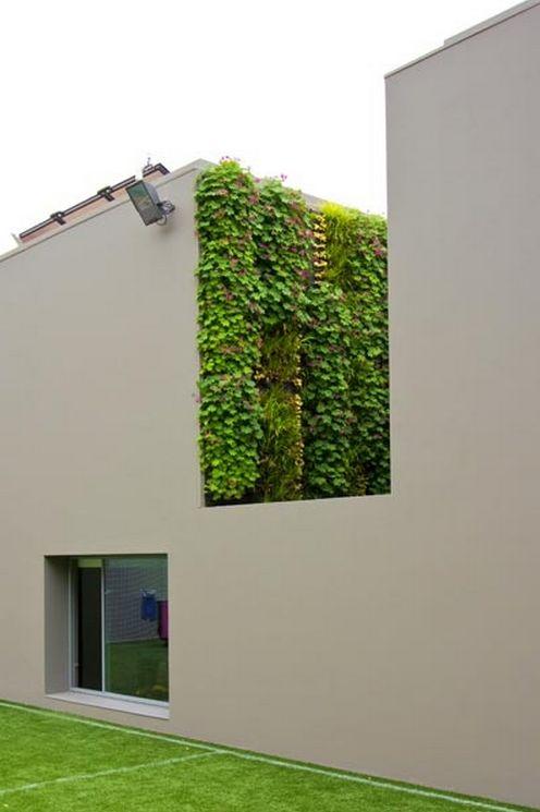 // Villa Cascais by Frederico Valsassina Arquitectos. Landscape by Proap. Vertical Garden by Vertical Garden Design