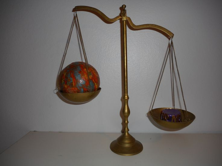 """""""Jesus Wins"""". Scale with burning globe and weight called Apokalupsis."""