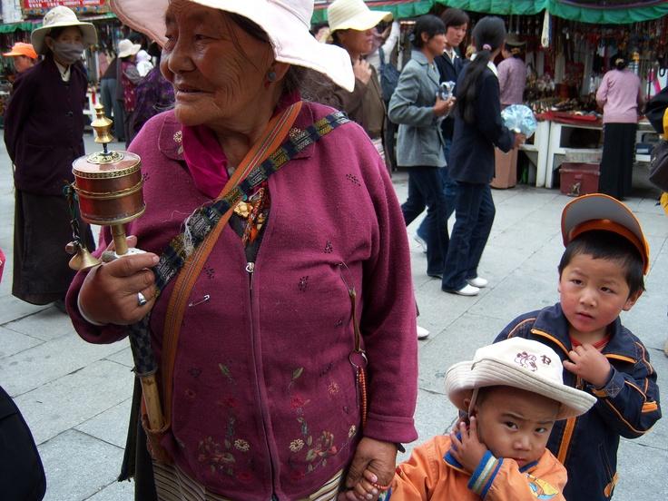 Religious woman and grandchildren in Thibet.