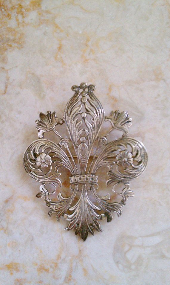 Beautiful Edwardian sterling silver brooch. Very finely detailed fleur de lis with floral accents. Engraved Sterling on back of brooch. Also marked in