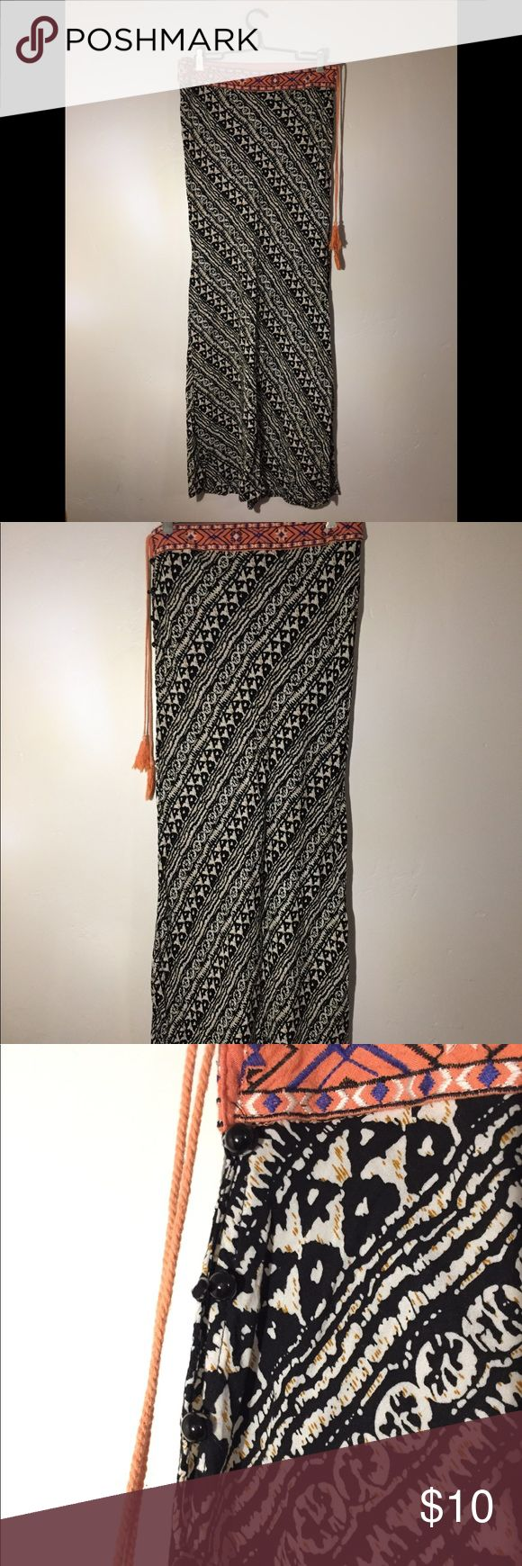 Flying Tomato tribal maxi skirt 100% viscose. Cute coral tassel, black button side closure, 42.5in length. Perfect condition, very flowy, comfortable and flattering. Flying Tomato Skirts Maxi