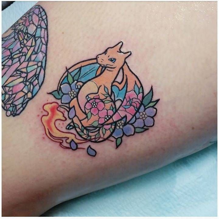 Kawaii style charizard tattoo.