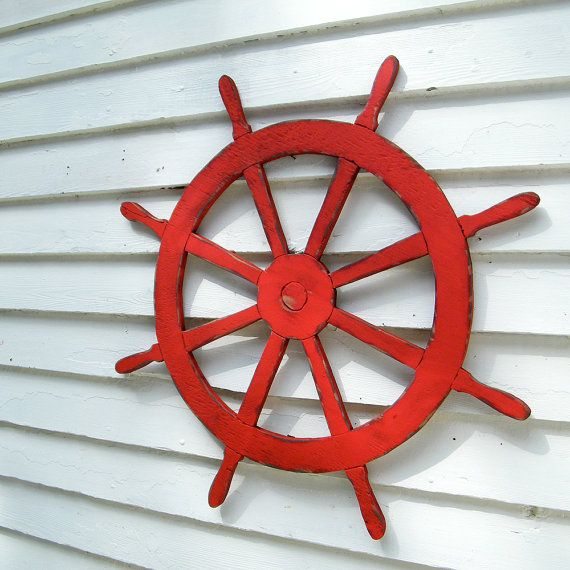 This is a classic Ships Wheel or helm which would go great with many of my other Beach and Coastal items. Shown here in Barnwood Red, you can