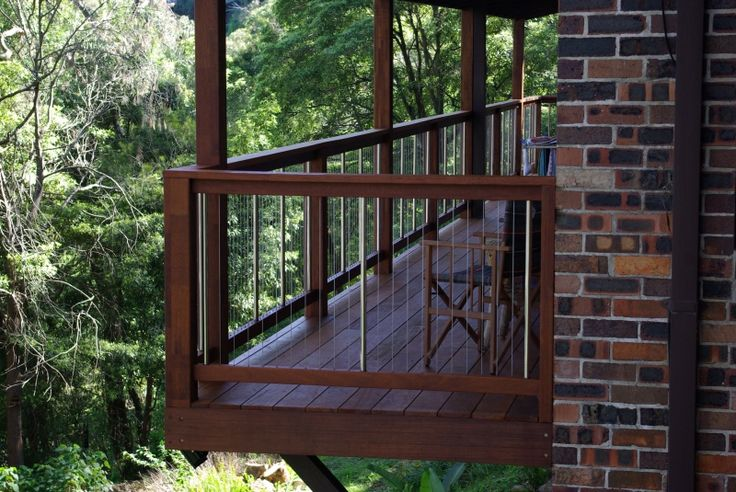 Balustrade incorporating beautiful Australian Hardwood rails, with Stainless Steel infill, or now with Extruded Aluminium in your choice of colour