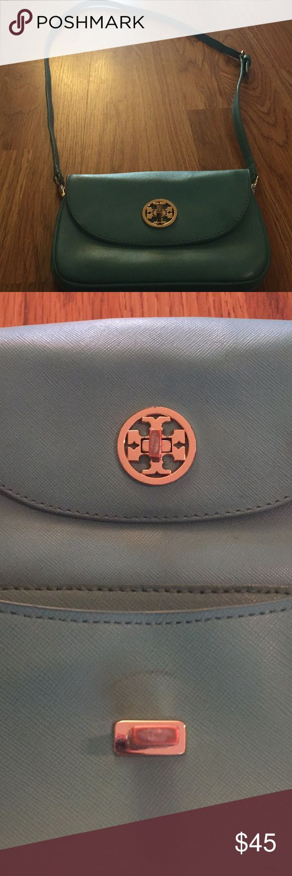 Tory Burch Mini Robinson in Mint green used cond This is a trendy Mint Green Tory Burch purse. It is the mini Robinson style. It is in used condition, I tried to get pictures of the flaws. It is being re-pushed as my Tory wallet won't fit well. It will fit a small card holder, cell phone and maybe some lip gloss. I tried to get pictures of the measurements so you can tell how long the strap is. It is supposed to be cross body, but it didn't fit my torso as a cross body. Great price for a…