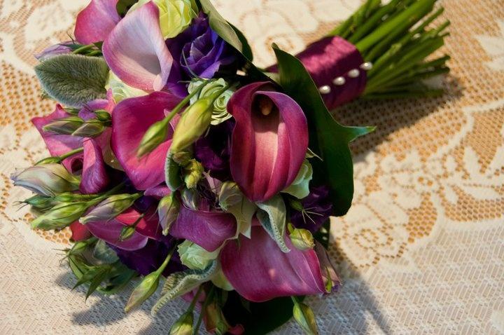 Purple lissianthus & cala lillies, green roses & lambs ear foliage, with monsteria leaves #weddings  www.RedEarthFlowers.com.au