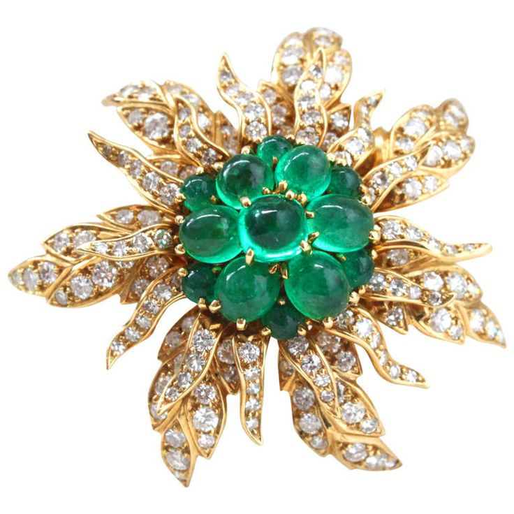 Cartier Emerald and Diamond Flower Brooch 1950s. A yellow gold emerald cabochon and diamond flower brooch by Cartier, signed and numbered. Cartier has crafted this piece on three parts, which are moveable and fixated through a screw at the back. The first two parts are the flower petals studded with high quality round single and brilliant cut diamonds, circa 4 carats. The inner part of the flower is studded with old mine Columbian emerald cabochons, circa 10 carats. c 1950s