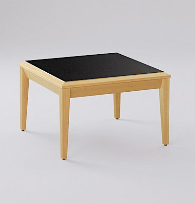 Common area tables feature an external High pressure laminate top with solid beech external knife edge and tapered solid beech legs and rails. Joinery is all traditional craftmanship utilizing dowels and glue reinforced with mechanical fastening.