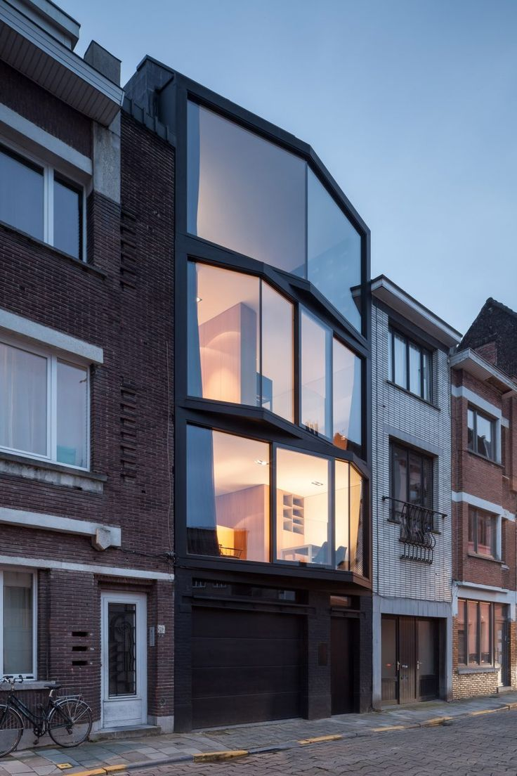 Angled glazing frames range of views from Ghent house by Steven Vandenborre and Mias Sys