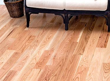 Unfinished Red Oak Hardwood Flooring in a renovated living room