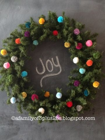 Oversized Pom Pom Christmas Wreath via: afamilyof3plus2bs.blogspot.com    Project or kids.  Front porch?