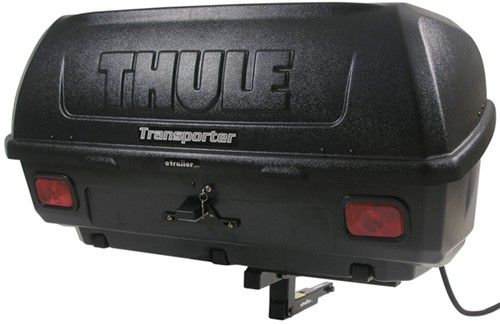 """Tilting, enclosed, hitch-mounted cargo carrier offers a great solution to transporting your gear. Includes a lock to keep it closed. 13 Cubic feet, 150-pound capacity. Works on 1-1/4"""" (Class II only) and 2"""" trailer hitches. Call 800-298-8924 to order Thule hitch cargo carrier part number TH665C or order online at etrailer.com. Free expert support on all Thule products. Guaranteed Lowest Price and Fastest Shipping for Thule Transporter Combi Hitch Mounted Enclosed Cargo ..."""