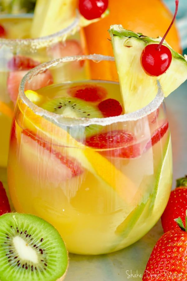 This Tropical Margarita Sangria recipe starts with white wine and then some simple ingredients.