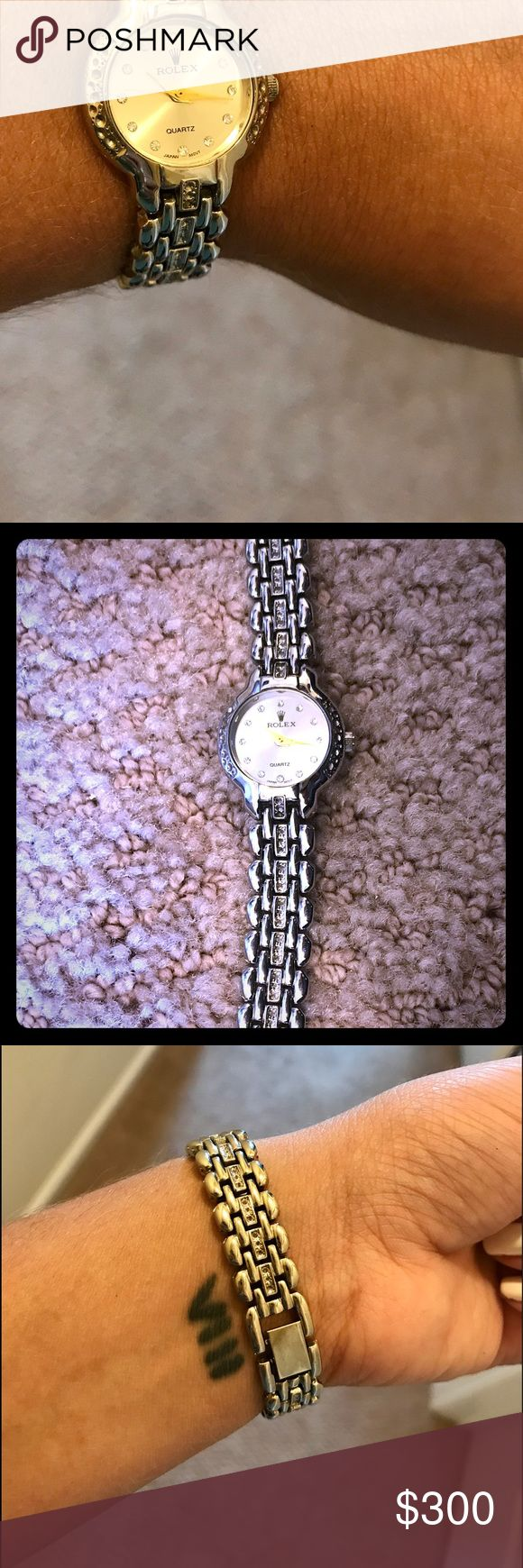 Women's Rolex watch in excellent condition! ✨ Absolutely gorgeous watch that I love but never wear. IDENTICAL to the original. Has all Rolex markings. Looks stunning on and is a perfect mix of mostly silver with gold hands and CZ detailing. Clasps perfectly in the back just needs a battery ($5). Price is negotiable - make an offer! Rolex Accessories Watches