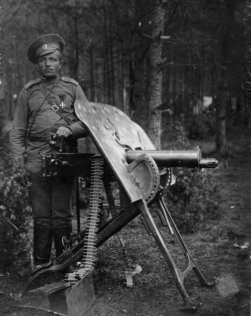 Gunner of the 5th Siberian Infantry Regiment posing with a captured German MG-08, 1914-17.