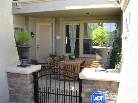 So for the front courtyard, maybe a small wrought iron gate with some pavers, seating, plants?  Keep it simple...