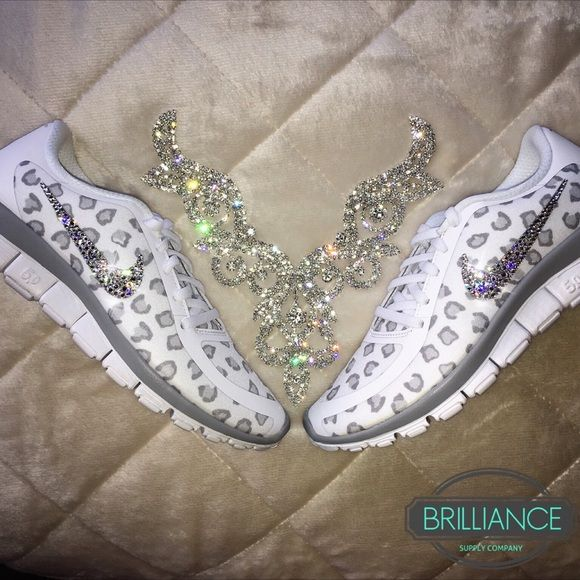 Swarovski Nike Free 5.0 v4 White Platinum Leopard Nike Free 5.0 v4 White Platinum Leopard   Outer Nike logos are encrusted with hundreds of genuine Swarovski® crystals in up to 16 different sizes to ensure maximum brilliance & shine.  Shoes are brand new in original box & are purchased directly from Nike authorized retailers.  ORDER 1/2 SIZE LARGER THAN NORMAL   Crystals are applied with industrial strength glue & will not come off.  *Note* These shoes are made to order.  Please allow up to…
