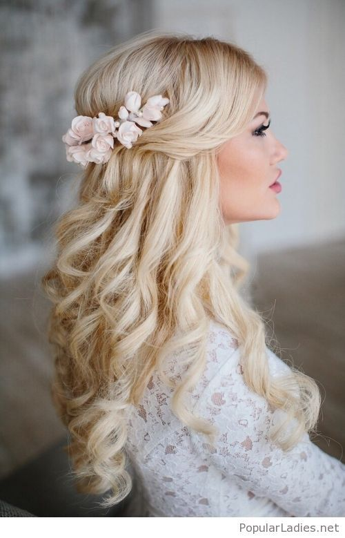Beautiful long blonde curly hair with pink roses