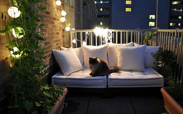 more ideas for small patios (I like the string of lights)