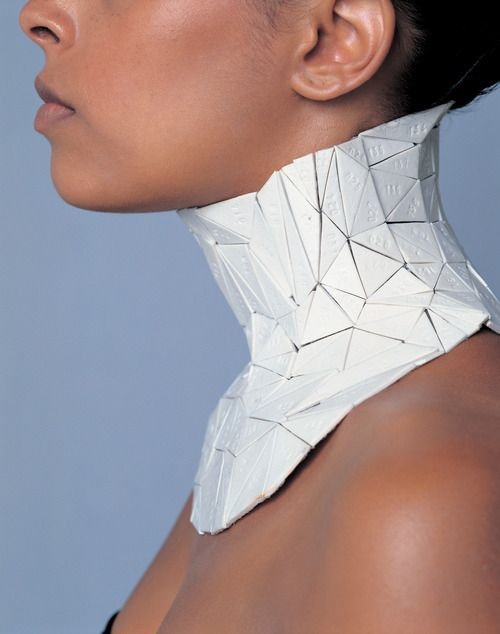 UNFOLD design (BE), WRITTEN ON THE BODY --    Unfolding a digital 3D body scan into a pattern and using this pattern to make personal jewels in different materials: silver (arm), porcelain (neck) and leather (belly). The model, consisting of triangular surfaces, gives the jewelry a nearly perfectly fitting form, truly made for the wearer. This project was nominated for the René Smeets Prize by the Design Academy Eindhoven in 2002.