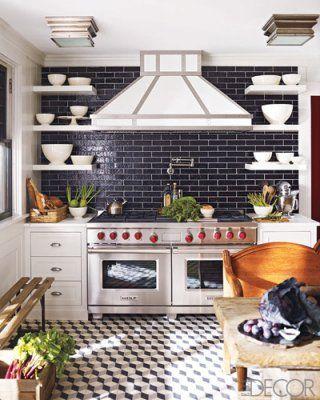 black tile backsplash, black and white tiled floor