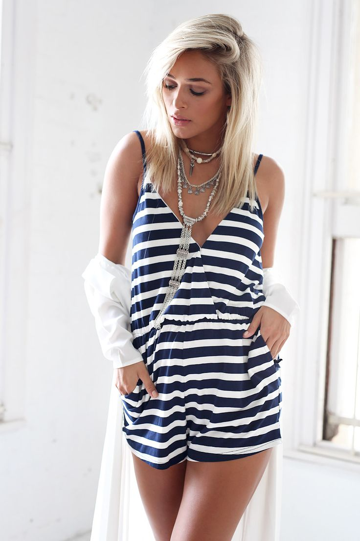 The Navy Stripe Jumpsuit features a flattering, crossover V neckline, a low V back, an elasticated waistband and adjustable straps. Mini style. By Sabo Skirt.